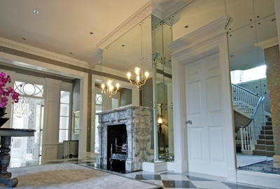 Art Deco style feature antique mirror glass entrance wall of private house.
