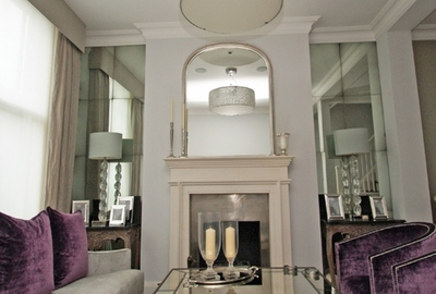 Private residence Kensington. Medium antiqued 8 panel mirrored alcoves.