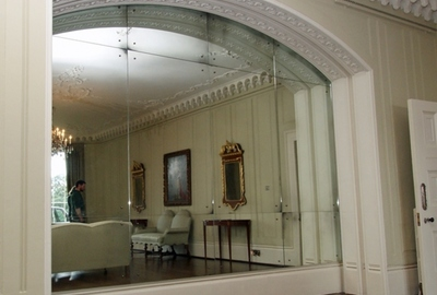 Private residence Somerset. Impressive 12 part light antique mirrored alcove.