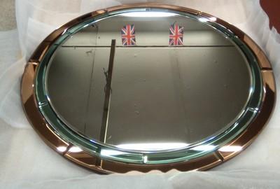 Restored circular segmented coloured mirror